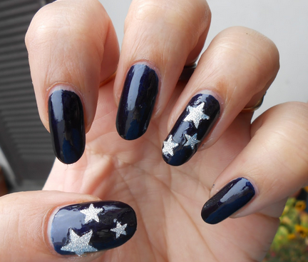 As you can see here, it's not alwasy necessary to add stars to each nail.  Here you can see a nice variation of dark blue nails which contain only a  few ... - Cute Star Nail Designs
