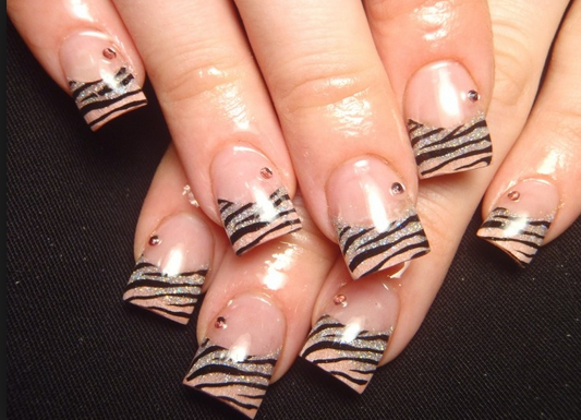 Zebra nail art design ideas here you can see a very cool variation to the standard zebra pattern using pink nails as you can see the zebra pattern is only used at the end of the nails prinsesfo Images